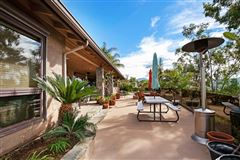 Mansions in Picture perfect single level home with incredible outdoor entertaining area