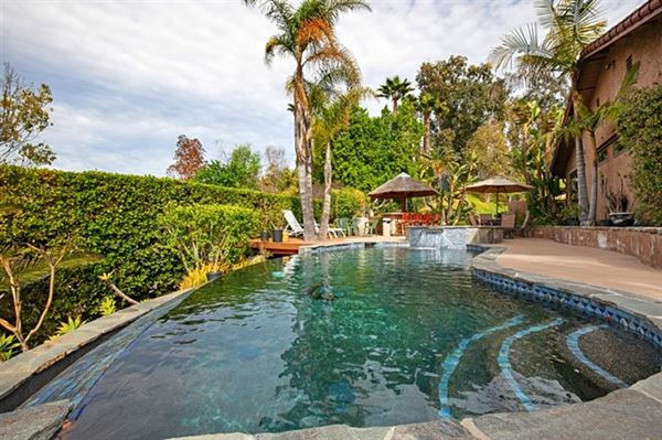 Luxury real estate Picture perfect single level home with incredible outdoor entertaining area