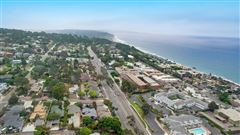 Mansions in this charming beach cottage is in the heart of Del Mar