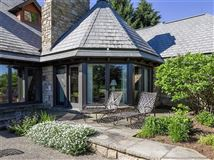 a Warm and welcoming stone home mansions