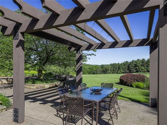 a Warm and welcoming stone home luxury real estate