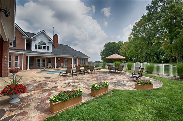 Luxury real estate an exquisite two-story brick farmhouse