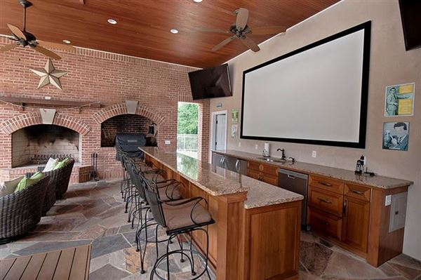 an exquisite two-story brick farmhouse luxury real estate