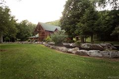 Luxury homes in fabulous log home on 20 acres