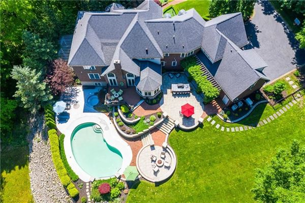 Palatial all brick estate on a private and peaceful two acre cul-de-sac setting luxury homes