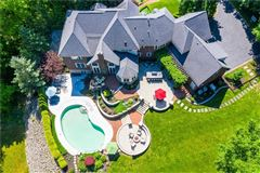Mansions Palatial all brick estate on a private and peaceful two acre cul-de-sac setting