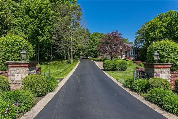 Luxury homes Palatial all brick estate on a private and peaceful two acre cul-de-sac setting