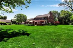 Luxury homes in this exceptional lakefront residence has captivating views of Lake Erie