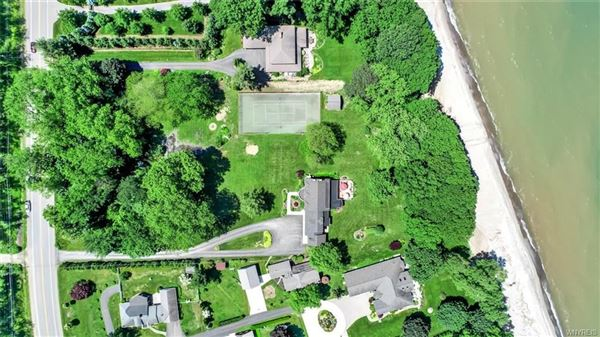 this exceptional lakefront residence has captivating views of Lake Erie luxury homes