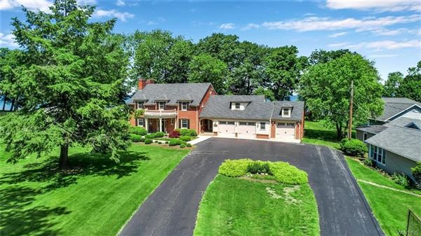 this exceptional lakefront residence has captivating views of Lake Erie luxury properties