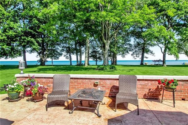 this exceptional lakefront residence has captivating views of Lake Erie mansions