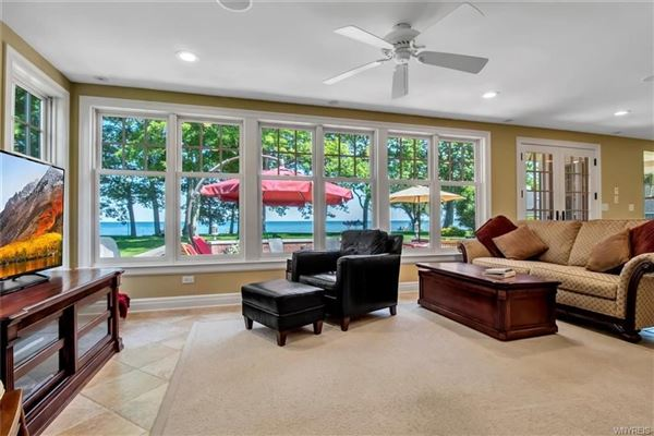 this exceptional lakefront residence has captivating views of Lake Erie luxury real estate