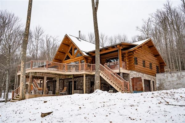 Luxury real estate custom built Montana Log home on over 50 acres