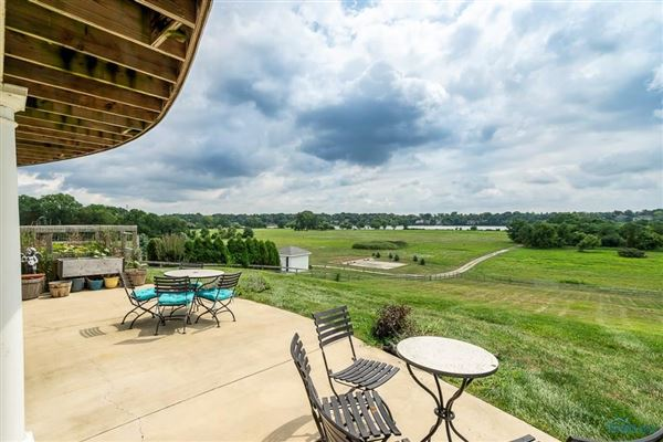 Luxury homes exquisite views of the river and sweeping meadow