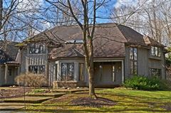 Luxury properties stately home on five private wooded acres