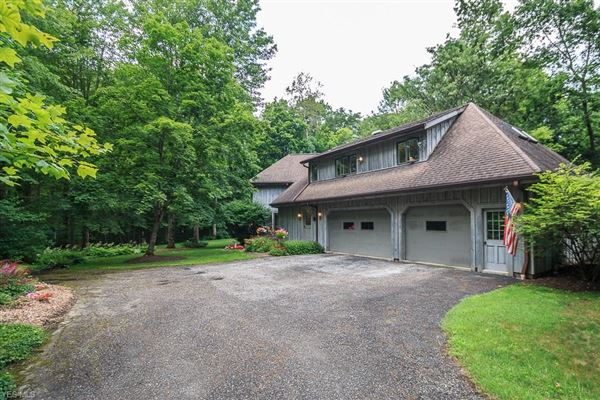 Luxury homes stately home on five private wooded acres