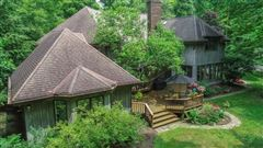 Luxury homes in stately home on five private wooded acres