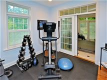 impeccable home boasts a hot tub and exercise room luxury homes