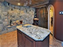 Luxury properties impeccable home boasts a hot tub and exercise room