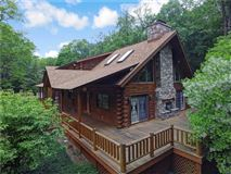 Mansions in luxury log home on 69 exceptional wooded acres