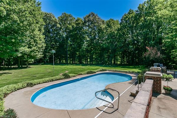 Luxury homes stately brick home on five wooded acres