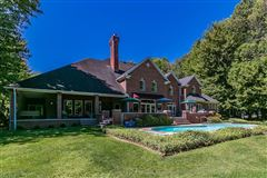 Luxury homes in stately brick home on five wooded acres