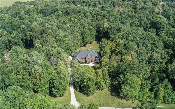 Luxury real estate stately brick home on five wooded acres