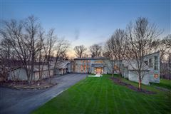 Unparalleled privacy on 10-plus wooded acres mansions