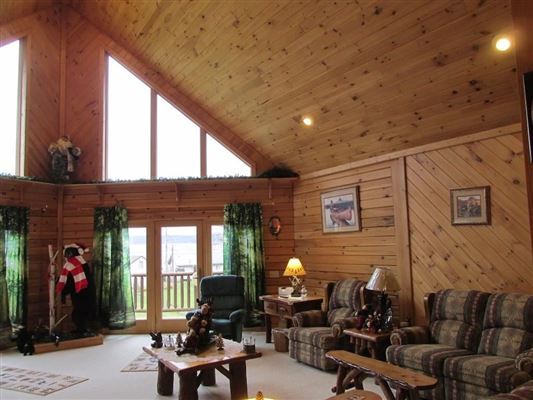 stately and spcaious lakefront log cabin mansions