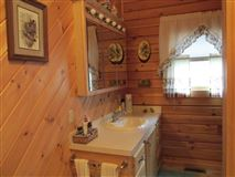 stately and spcaious lakefront log cabin luxury real estate