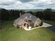 Luxury homes in gorgeous two-story all brick home in a private setting