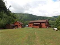 Luxury properties custom log home on 119 acres