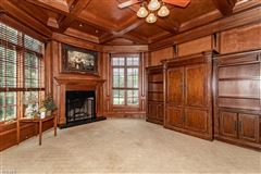 Luxury real estate The dramatic two-story foyer is accented by hardwoods, faux finishes and a chandelier