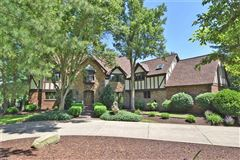 One of a kind custom Tudor style home luxury real estate