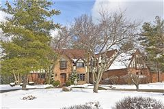 One of a kind custom Tudor style home luxury properties