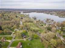 Luxury homes in Five acre island on Turkeyfoot Lake