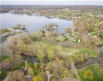 Mansions in Five acre island on Turkeyfoot Lake
