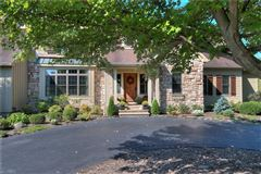 Luxury properties beautiful two-story foyer offers an outdoor deck
