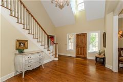 beautiful two-story foyer offers an outdoor deck luxury properties