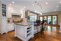 beautiful two-story foyer offers an outdoor deck luxury homes