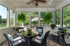beautiful two-story foyer offers an outdoor deck luxury real estate