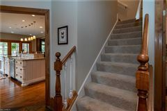 Mansions beautiful two-story foyer offers an outdoor deck
