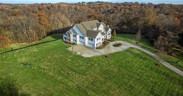 impeccably-crafted home on six-plus acres luxury real estate