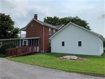 renovaTED BRICK COLONIAL ON 262 ACRE FARM luxury properties
