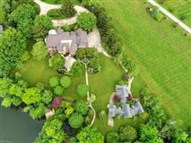 custom built Tudor style home luxury homes