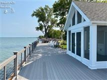 Luxury homes in custom home on a lake to bay Cedar Point lot