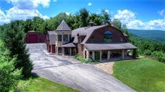 Luxury homes in this custom home has 360 degree views and privacy atop a mountain