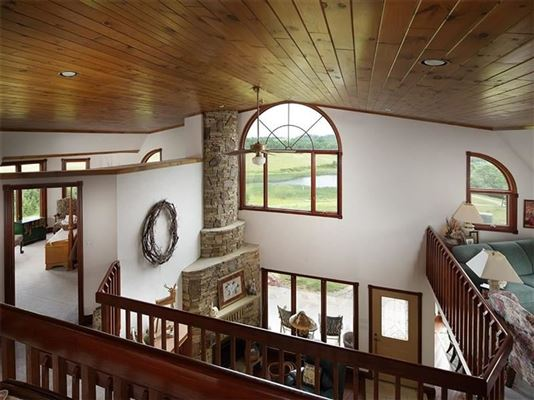 this custom home has 360 degree views and privacy atop a mountain mansions