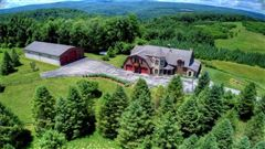 this custom home has 360 degree views and privacy atop a mountain luxury real estate