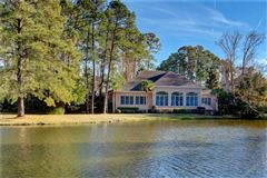 Luxury homes in 106 Augusta - on the lagoon with golf course views